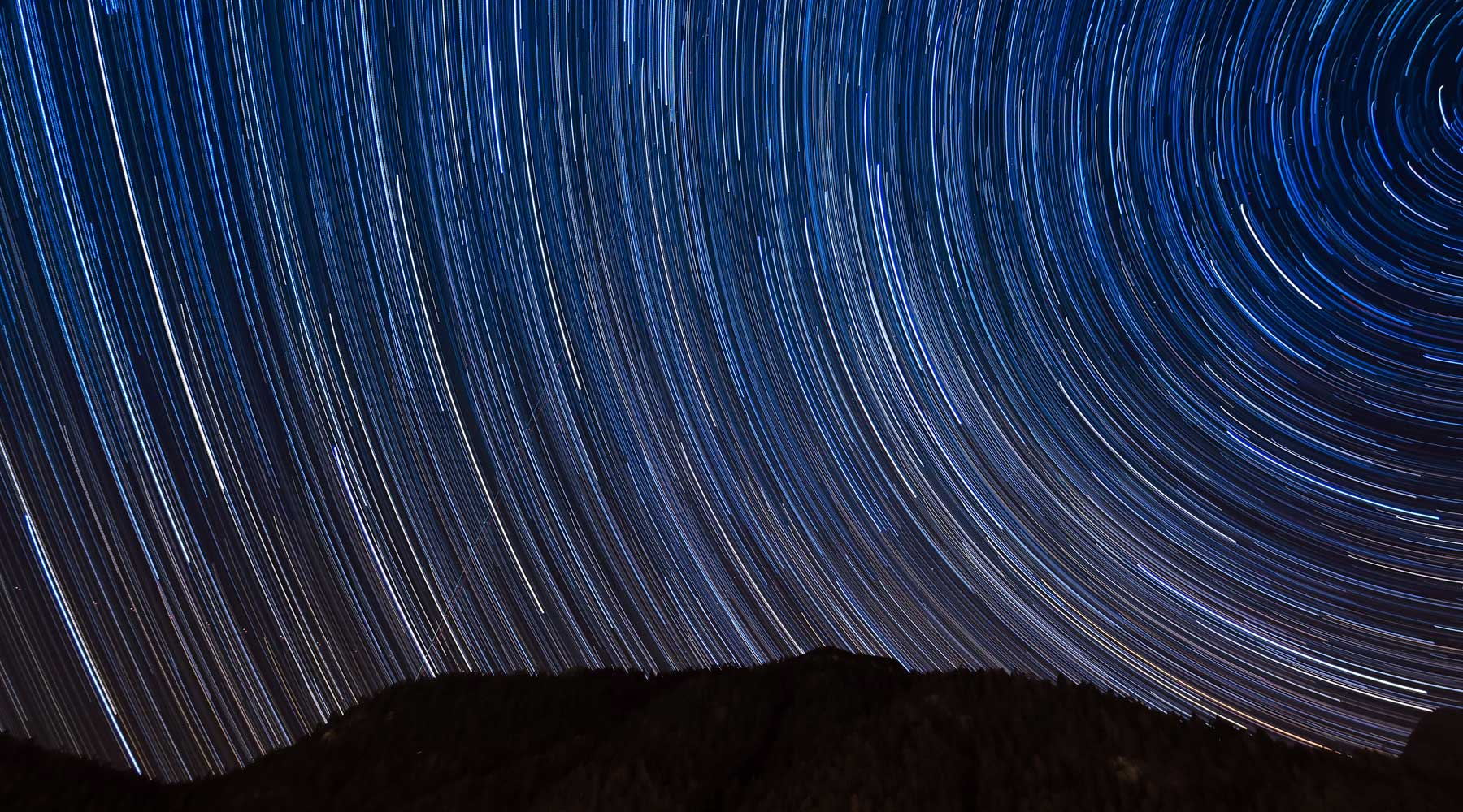 Long exposure photo of stars used for astronomy visual branding